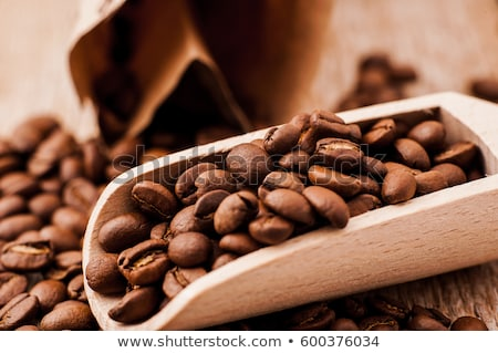 cup of black coffee on colored cloth and roasted coffee beans cl Stock photo © mizar_21984