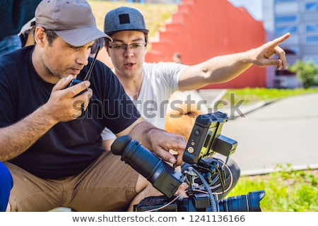 camera operator, director of photography and director discuss the process of a commercial video shoo Stock photo © galitskaya