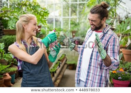 Mann Frau stehen zusammen Wasser Blumen Stock foto © dash