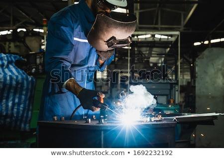 Hegesztő dolgozik gyár szikrák repülés munkás Stock fotó © Kzenon