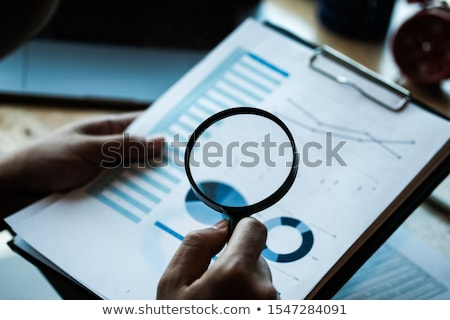 Business Fraud Investigation With Magnifying Glass Stock photo © AndreyPopov