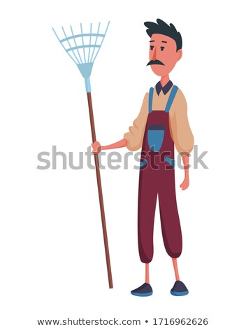 Happy mustachioed man gardener or farmer with pitchfork on a white background. Cartoon character of  Stock photo © designer_things