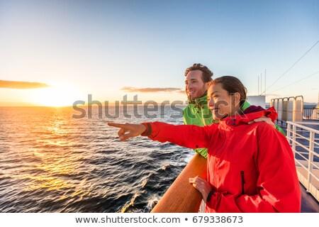 ストックフォト: Cruise Travel Tourists Couple Pointing At Sea View From Ferry Tour Asian Woman Multiracial People T