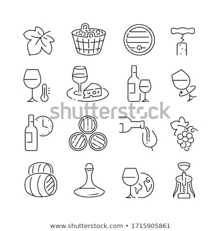 Bunch of white grapes in a basket and a glass of wine stock photo © g215