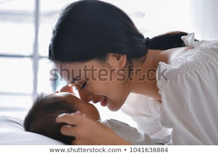 Mom holding little crying boy Stock photo © AndreyKr