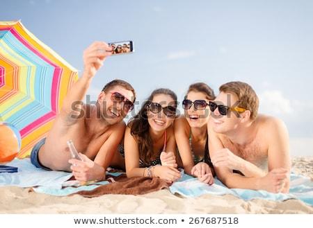 ritratto · rilassante · donna · sabbia · spiaggia · cielo - foto d'archivio © photography33