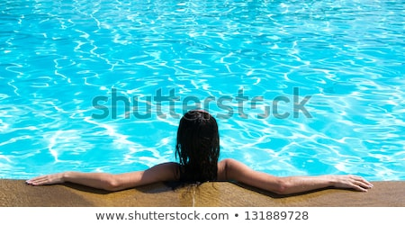 Brown-haired woman in swimming pool Stock photo © photography33