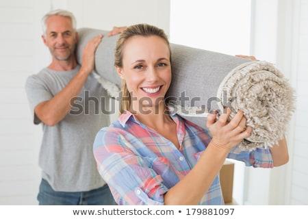 Сток-фото: Couple Carrying Carpet