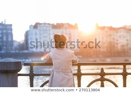 Admiring gaze of young woman on white background Stock photo © pzaxe