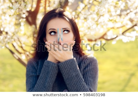 Woman with flower on her nose Stock photo © photography33