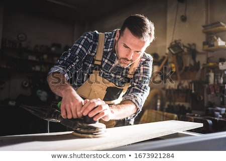 carpenter at work with sander machine Stock photo © photography33