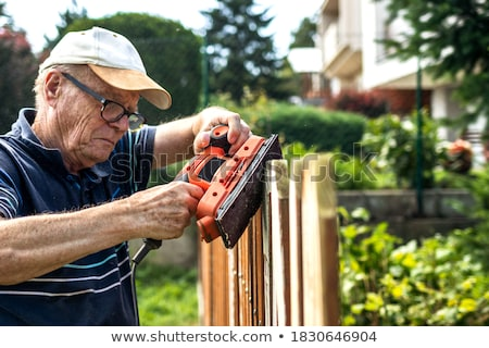 Man using electric sander Stock photo © photography33