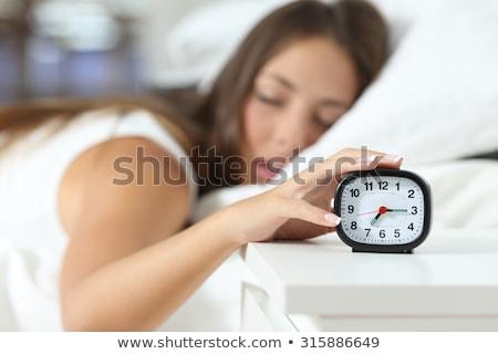 despertador · homem · cama · manhã · homens - foto stock © rtimages