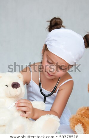 Female doctor injecting a teddy bear Stock photo © photography33
