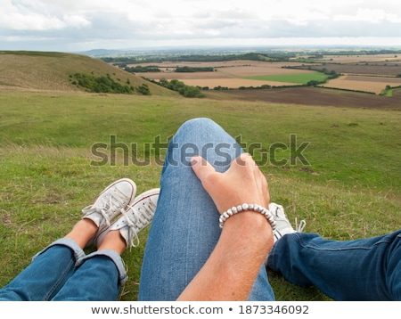 Couple laid on grass Stock photo © photography33