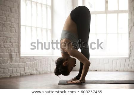 Előre görbület kép fitnessz oktató gyakorol Stock fotó © dolgachov