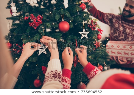 Christmas-tree decoration on hand Stock photo © ssuaphoto