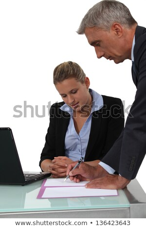 secretary helping her boss fill in paperwork stock photo © photography33