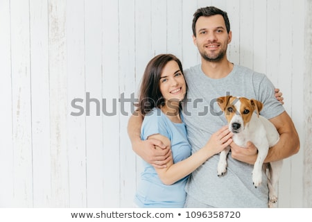 Young couple hugging against a white background stock photo © wavebreak_media