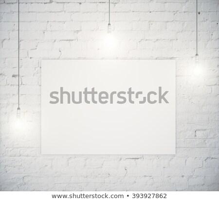 light bulb and blank paper on black board stock photo © matteobragaglio