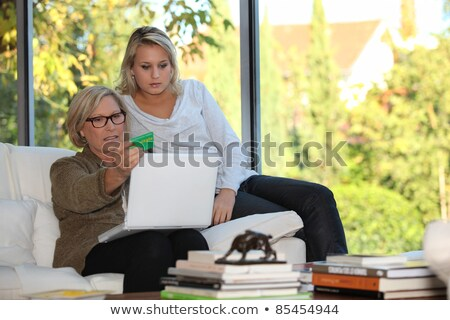 mother and daughter checking social security online stock photo © photography33