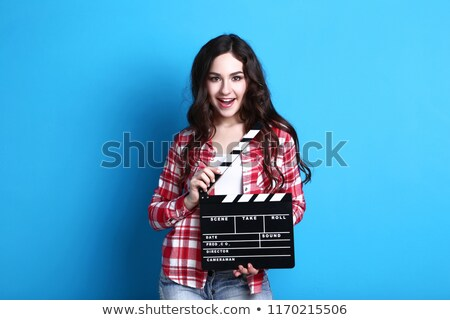 Cute Young Woman Holding Clapper Board Stock photo © williv