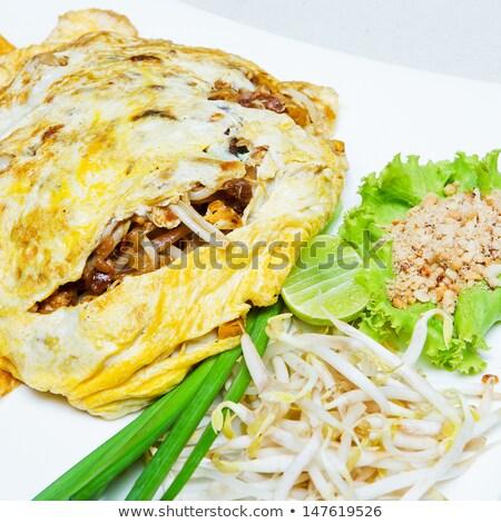 Stir Thailand wrapped fried eggs Stock photo © AEyZRiO
