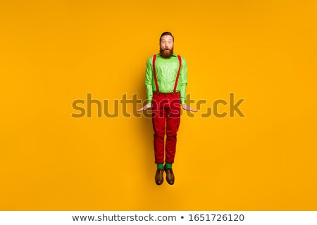 Young man in red socks jumping high in the air Stock photo © stevanovicigor