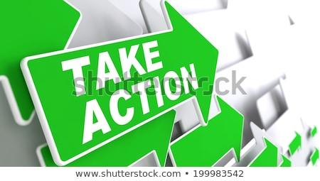Take Action on Green Direction Arrow Sign. Stock photo © tashatuvango