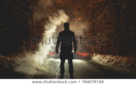 Mysterious man lighting a cigarette Stock photo © Nejron