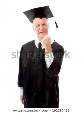 senior male graduate punching the air stock photo © bmonteny