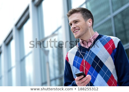 Handsome smiling guy in casual attire Stock photo © stockyimages