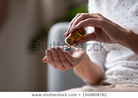Nurse holding prescription medicine Stock photo © Klinker