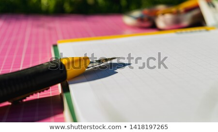 Knife cut paper with obstacle Stock photo © fuzzbones0