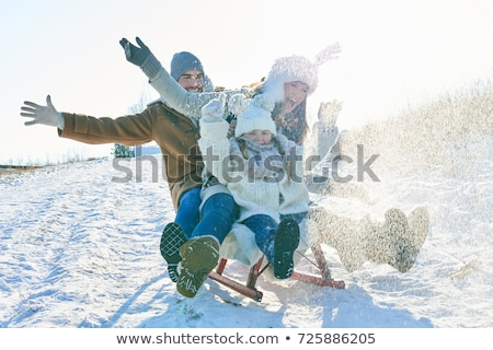 Сток-фото: Mother With Sled And Children In Park At Winter