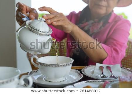 hands pouring tea stock photo © deandrobot
