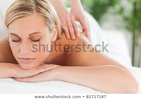 Woman Lying On A Lounger In Wellness Center Stock photo © dash