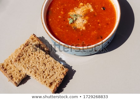 warm bread bowl of lentil soup and red napkin stock photo © ozgur