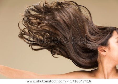 Beautiful woman with curly hair isolated on beige Stock photo © dashapetrenko