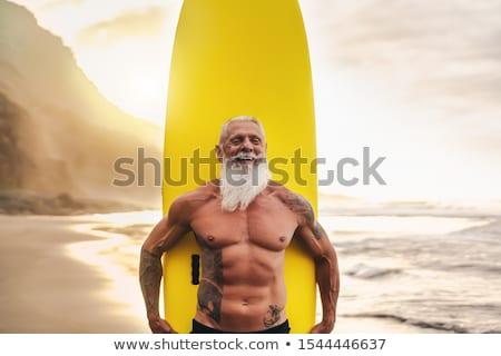 hombre · surf · ola · cielo · energía · aprendizaje - foto stock © cienpies