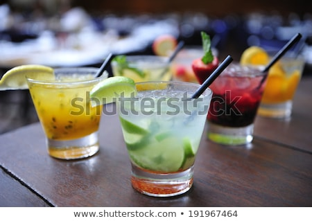 Summer cocktails on a rustic wood Stock photo © Yatsenko