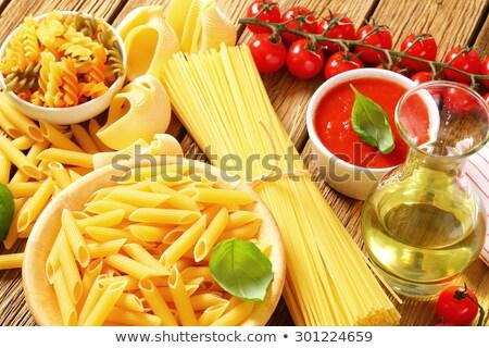 Pasta pomodoro olio d'oliva legno alimentare spaghetti Foto d'archivio © Digifoodstock