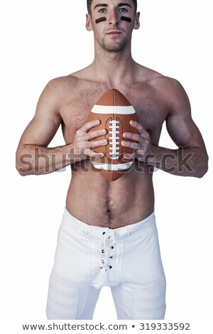 Portrait of shirtless male athlete with rugby ball Stock photo © wavebreak_media