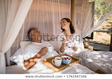 felice · uomo · donna · colazione · letto · insieme - foto d'archivio © wavebreak_media