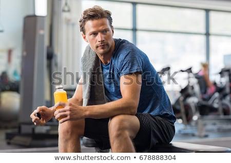 Zmęczony sportowiec relaks posiedzenia siłowni kobiet Zdjęcia stock © wavebreak_media