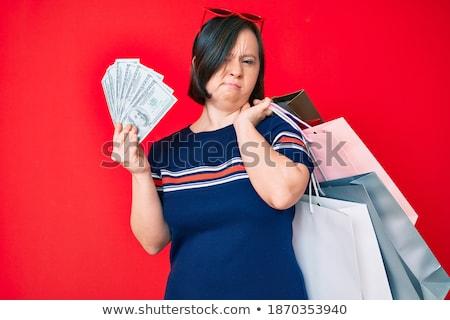 Portrait of frowning brunette Stock photo © wavebreak_media