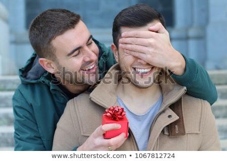 Gay homme surprenant copain heureux maison Photo stock © wavebreak_media