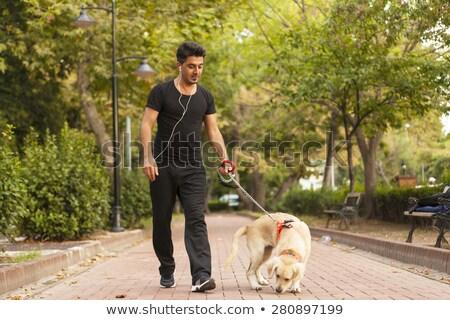 Stok fotoğraf: Sportsman Walking With Dog