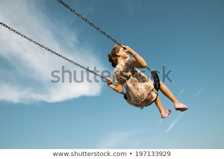 Woman on a swing, blue sky above Stock photo © IS2
