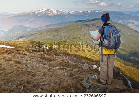 climber looking at map stock photo © is2